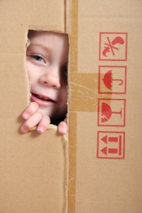 Child looking from box